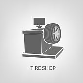 Computer wheel balancer beautiful vector illustration useful for icon and type design on a light background. Flat graphic style. Transportation automotive concept. Digital pictogram in grey colours
