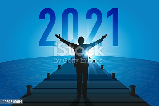 istock Concept of a renaissance of the economy, with an optimistic man who opens his arms to welcome the year 2021. 1279319954