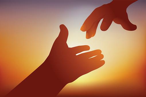 Concept de l'entraide avec deux mains qui se tendent l'une vers l'autre pour se porter secours.
