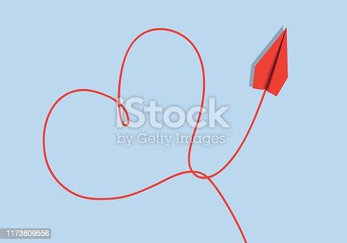 Concept de la déclaration d'amour avec un message romantique présentant un cœur dessiné par un avion en origami