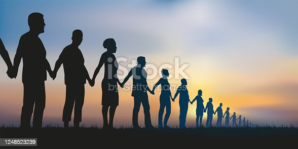 istock Concept of solidarity with a group of people who form a human chain to demonstrate. 1248523239