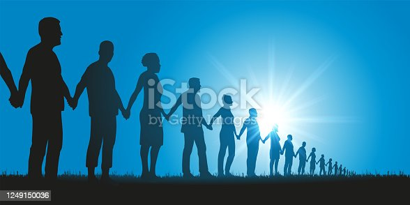 istock Concept of solidarity with a group of people who form a human chain to demonstrate. 1249150036