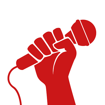 Concept of the fight for freedom of information with a raised fist holding a microphone.