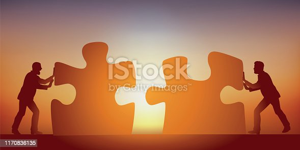 istock Concept of the union that makes strength, with two men who unite their reflections symbolized by two pieces of puzzle. 1170836135