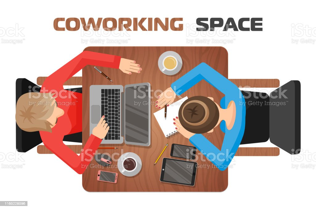 Concept of workplaces in co-working space for two people. Two girls...