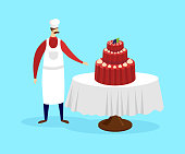 Confectioner Standing near Table with Festive Cake