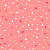 Confetti with hearts. Seamless vector pattern on pink background