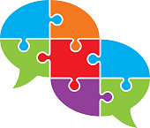 Vector illustration of two colorful connected puzzle pieces speech bubble.