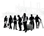 Silhouette crowd of workers doing a variety of jobs and professions related to the construction industry