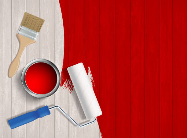 Construction tool with paint on a wooden table. Paint roller, paint brush and a bucket on a wooden table. Construction tools. Vector illustration. renovation stock illustrations