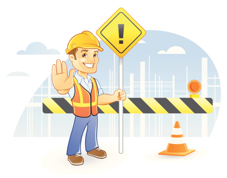 Construction Worker in Hardhat Holding Sign