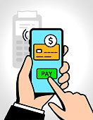 Hand holding smartphone, and finger pushes pay button on the phone, customer using phone when shopping. Shopping by phone and connected card. Shopping, contactless payment via smartphone concept.