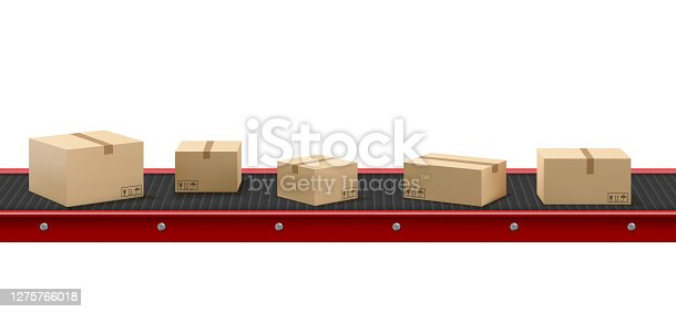 istock Conveyor belt with cardboard boxes at factory 1275766018