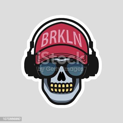 istock Cool skull in a cap and headphones 1070886992