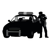 A vector silhouette illustration of a police officer standing beside his police cruiser with a detainee in tha back seat.
