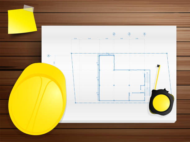bildbanksillustrationer, clip art samt tecknat material och ikoner med copy space working tool hard hat with blueprints on wood - construction workwear floor