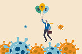 istock Coronavirus crisis, COVID-19 pandemic impact all business and company with help of banking and government to reduce interest rate and stimulus package, businessman holding balloons fly pass virus. 1218710519