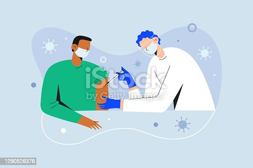 istock Coronavirus vaccination, doctor injecting a patient, getting first shot of covid vaccine in arm muscle. Medical doctor in protective suit and mask, process of immunization against covid-19 1290526376