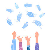 istock Coronovirus quarantine is over. Pandevic end. COVID-2019. Hands toss up medical protective masks, gloves and bottles with a disinfectant. 1224209854