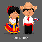 Costa Ricans in national dress with a flag.