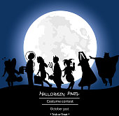 A vector silhouette illustration of children dressing up for Halloween in front of a full moon.