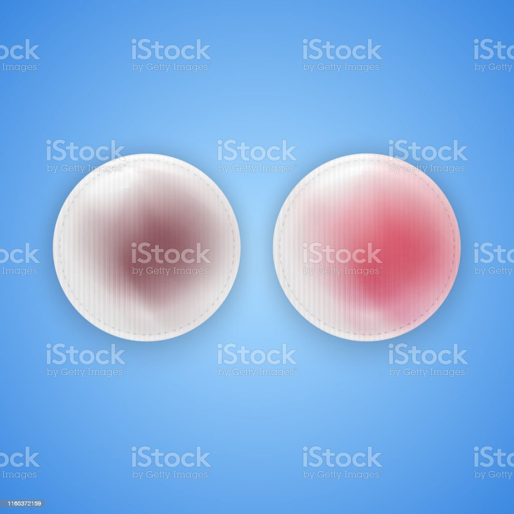 Cotton pads on blue background, dirty and used cotton pads for makeup...