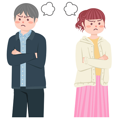 A couple angry with each other and facing outwards.