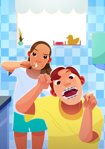 Couple brushing and Flossing Teeth together in the Bathroom.