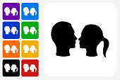 Couple Facing Each Other Icon Square Button Set. The icon is in black on a white square with rounded corners. The are eight alternative button options on the left in purple, blue, navy, green, orange, yellow, black and red colors. The icon is in white against these vibrant backgrounds. The illustration is flat and will work well both online and in print.