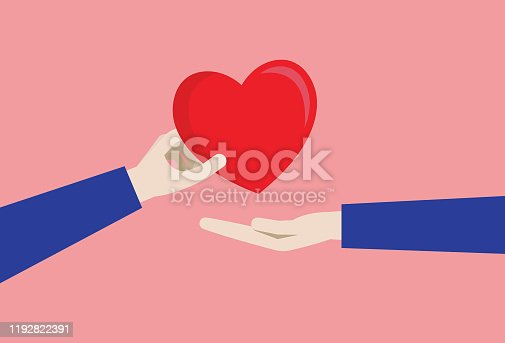 istock A couple gives a red heart 1192822391