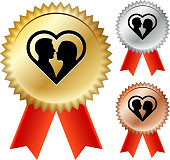 Couple & Heart Gold Medal Prize Ribbons. This illustration features the main icon on a golden medal with a red ribbon. The medal has a starburst effect and a realistic golden color and texture. There are two alternate medal variations on the right of the image. One in Silver and one in bronze color. This vector image is ideal for completion and event award concepts.