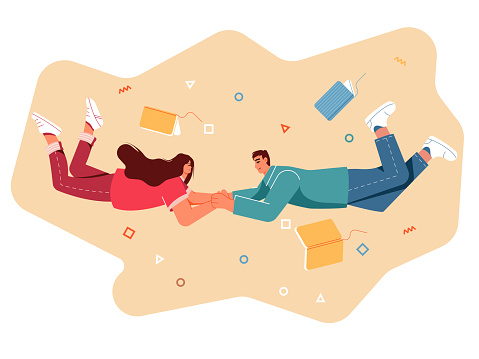 Couple holding flying between books.