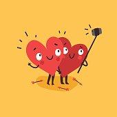 Couple in love. Two happy hearts making selfie.