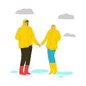 Hand drawn young couple in raincoats and rubber boots standing and enjoying rainy weather over white background vector illustration. Rainy happiness concept