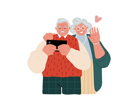 A couple of elderly people with a cell phone. Senior people using smart devices.