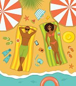 Couple on the beach top view. Man and Woman sunbathing on striped towels . Summer Time Vector Illustration with people, beach accessories, umbrellas, floats, starfish, cocktails, diving mask, paddles, etc