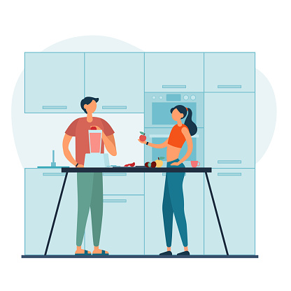 Couple preparing healthy drink in kitchen together