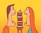 Couple sharing a huge hamburger