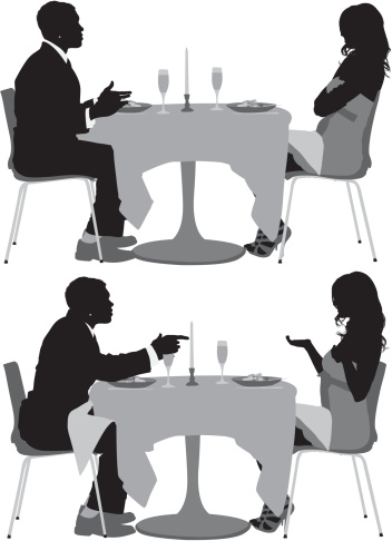 Couple sitting in a restaurant and arguing to each other