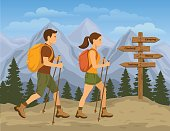 Couple traveling in Mountains. Man and Woman Hiking
