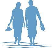 Vector illustration of a silhouette of a couple walking at the beach.