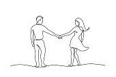 istock Couple walking holding hands 1270608479