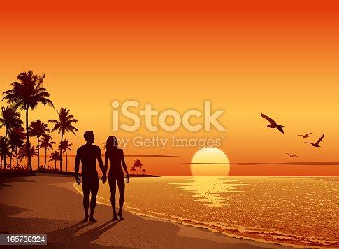 istock Couple walking on the Beach at Sunset 165736324