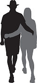 Vector silhouette of a young man and woman walking together with their arms around each other.