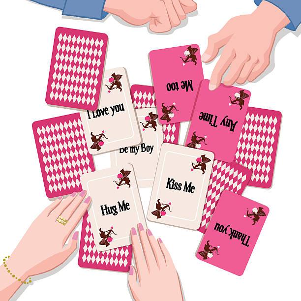 paar mit spielkarten mit liebe nachricht - paararmbänder stock-grafiken, -clipart, -cartoons und -symbole