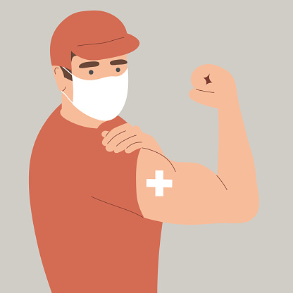 A courier who has the coronovirus vaccine, covid-19. The delivery guy shows the graft on his arm. Safe delivery.