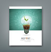 Cover annual report green seedlings in a light bulb