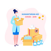 Goodwill Mission in Suffering from Coronavirus Epidemic. Doctor with box in hand.