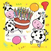Two cool cows have a party with massive cake.