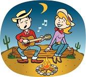 Cowboy At Campfire With Girl